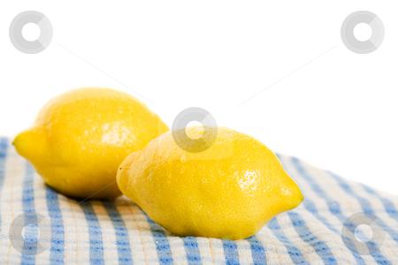 Fresh Lemons stock photo, Two fresh lemons isolated on a blue tea towel. by Brenda Carson