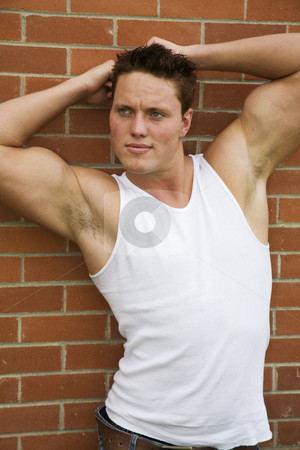 Muscular Male stock photo, A handsome young male with a very muscular frame. by Brenda Carson