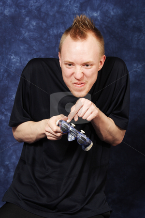 Satisfying Annihilation stock photo, An angry and frustrated gamer derives great satisfaction in annihilating his video opponent. by Brenda Carson
