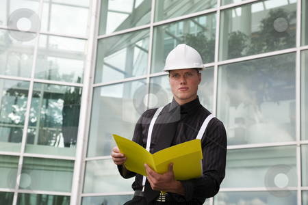Foreman At Work stock photo, A foreman holding a folder outside of the office. by Brenda Carson