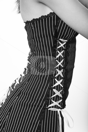 Laced stock photo, Fashion detail.  Pinstriped dress with back and sides laced in white ribbon. by Brenda Carson