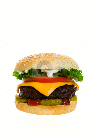 Beautiful Burger stock photo, Juicy Angus beef burger topped with cheese, tomatoes & lettuce on a golden sesame seed bun.  Shot on white background. by Brenda Carson