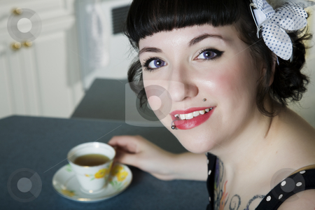 Tea Time stock photo, A rockabilly style girl enjoying tea. by Brenda Carson