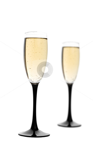Champagne stock photo, Two black-stemmed wine flutes filled with champagne.  Focus on first glass. by Brenda Carson