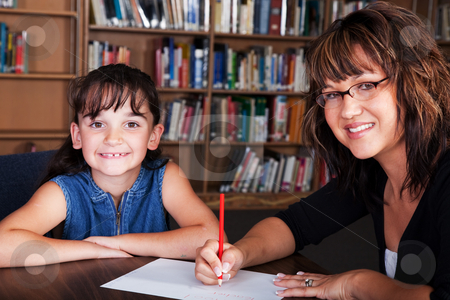 Happy Spelling Student stock photo, A happy child learning spelling from her tutor. by Brenda Carson