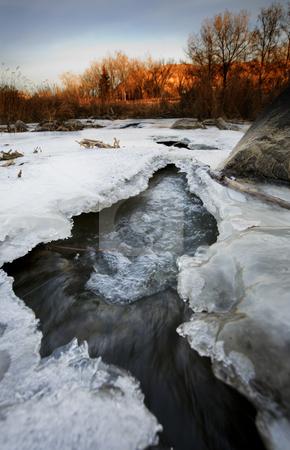 November Ice stock photo, A half frozen river in November.  Shot in early morning.  Kin Coulee, Medicine Hat, Alberta, Canada. by Brenda Carson