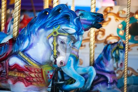 Carousal Horses stock photo, Blue carousal horses on a carnival merry-go-round. by Brenda Carson