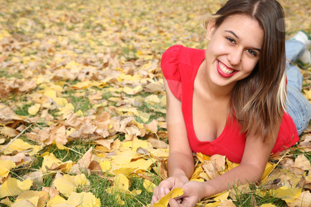 Autumn Portrait stock photo, Fall portrait of a smiling girl laying in the leaves. by Brenda Carson