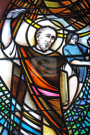 St.John in glass. stock photo, A stained glass window depicting Saint John of the christian faith. by Adam Goss