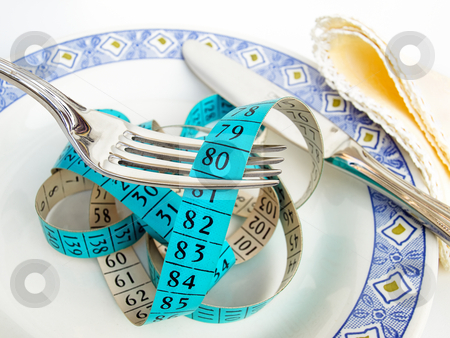 Delicious meal stock photo, Conceptual photo of a measure tape in the plate  which can suggest metaphors like diet,nutrition, healthy lifestyle etc. by Sinisa Botas