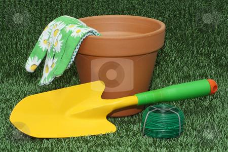 Gardening tools stock photo, Gardening tools and a flower pot on green grass meaadow by Birgit Reitz-Hofmann
