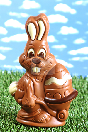 Sweet rabbit stock photo, Chocolate easter rabbit on grass by Birgit Reitz-Hofmann