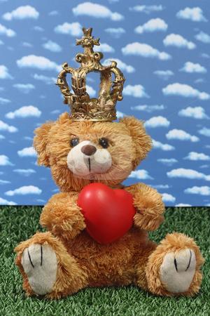 King teddy bear stock photo, Teddy bear with a crown and red heart. Shot in studio by Birgit Reitz-Hofmann