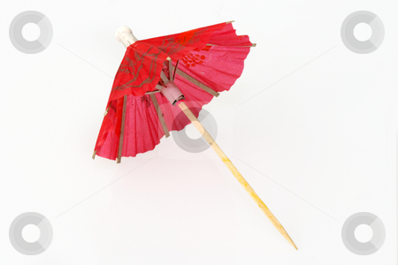 Cocktail umbrella stock photo, Red cocktail umbrella on bright background by Birgit Reitz-Hofmann