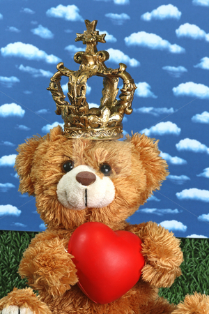 King Teddy stock photo, Cute teddy bear with toy heart on bright background by Birgit Reitz-Hofmann