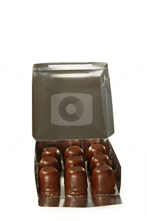 Chocolate marshmallows stock photo, Chocolate marshmallow in a box isolated on white background by Birgit Reitz-Hofmann