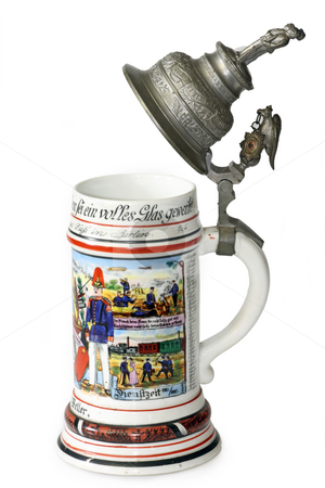 Vintage beer jug stock photo, A traditional German military beer jug the with silver lid isolated on white background. by Birgit Reitz-Hofmann