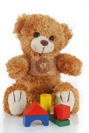 Building bricks stock photo, Cute teddy bear on bright background by Birgit Reitz-Hofmann