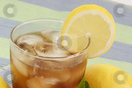 Lemon ice tea_13 stock photo, A glass full of Ice Tea with a lemon slice on bright background by Birgit Reitz-Hofmann