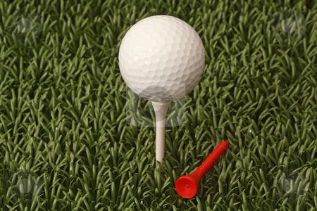 Golf ball stock photo, A white golf ball on a tee. A macro image. by Birgit Reitz-Hofmann