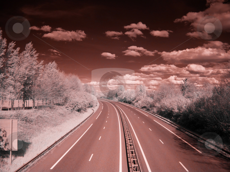 Infrared highway stock photo, Infrared picture of an empty highway with stormy clouds by Laurent Dambies
