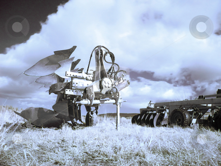 Plough machines  on fields stock photo, Infrared picture of plough machines  on field by Laurent Dambies