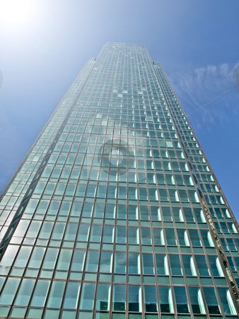 Skycraper and sunlight stock photo, Modern glass skycraper with sunlight by Laurent Dambies