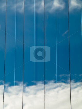 Building reflection stock photo, Close up of a glass building with sky reflection by Laurent Dambies