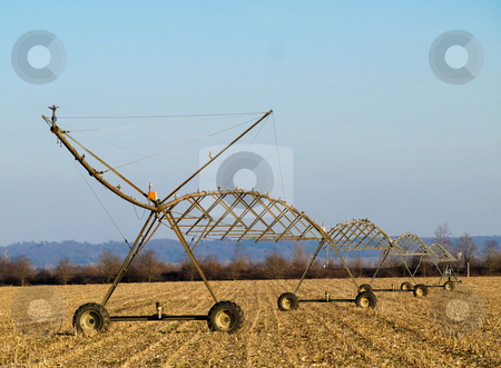 Water irrigation system stock photo, Water irrigation system on harvested corn field by Laurent Dambies