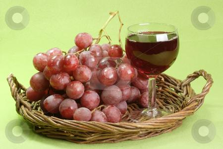 Red wine stock photo, Red wine on green background by Birgit Reitz-Hofmann