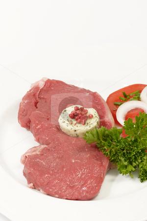 Raw beef stock photo, Raw roast beef with garnish on bright background by Birgit Reitz-Hofmann