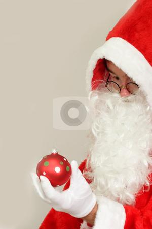 Chrismas ball stock photo, Male caucasian model of santa claus on grey background by Birgit Reitz-Hofmann