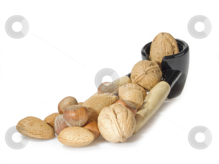 Nutcracker stock photo, Nutcracker and a walnut isolated on white background by Birgit Reitz-Hofmann