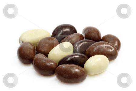 Chocolate almopnds stock photo, Small oval almond chocolates  on bright background by Birgit Reitz-Hofmann