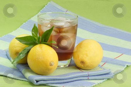 Lemon ice tea_16 stock photo, A glass full of Ice Tea with a lemon slice on green background by Birgit Reitz-Hofmann
