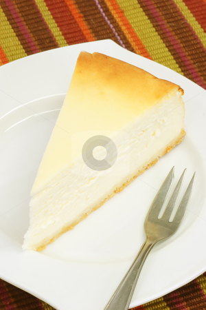 Cheesecake stock photo, Slice of cheesecake on a kitchen plate by Birgit Reitz-Hofmann