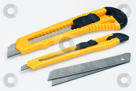 Cutter stock photo, Box cutter and blades on bright background by Birgit Reitz-Hofmann