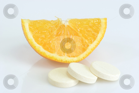 Vitamins_2 stock photo, Large pills with orange fruits tube on bright background by Birgit Reitz-Hofmann