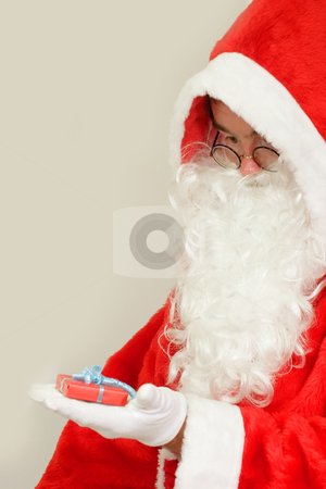 Chrismas present stock photo, Male caucasian model of santa claus on grey background by Birgit Reitz-Hofmann