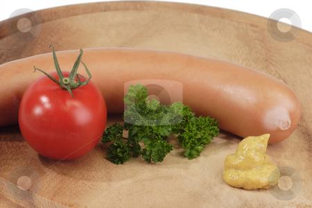 Sausage_1 stock photo, Crisp sausage on a wooden board. Shot in studio by Birgit Reitz-Hofmann