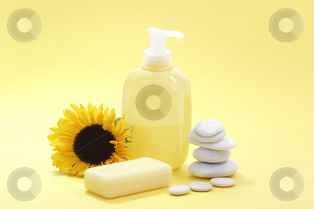 Liquid soap stock photo, Soap and a sunflower on yellow background by Birgit Reitz-Hofmann