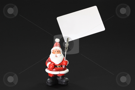 Paper holder stock photo, Santa clause figure as paper holder isolated on black background by Birgit Reitz-Hofmann