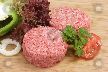 Meatballs stock photo, Raw mincemeat in detail on brown background by Birgit Reitz-Hofmann