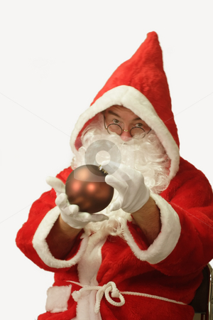 Santa with Christmas Ball stock photo, Male caucasian model of santa claus - isolated on white background by Birgit Reitz-Hofmann