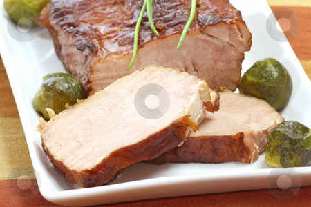 Roasted pork meat stock photo, Roasted meat and brussel sprouts on brown background by Birgit Reitz-Hofmann