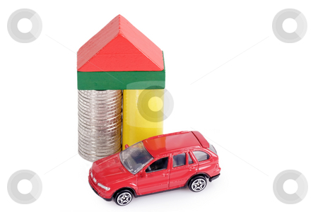 Euro coins stock photo, Toy bricks and euro coins and a toy car on bright background by Birgit Reitz-Hofmann