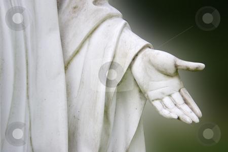 Peace stock photo, Detail friom a stone hand with dark background by Birgit Reitz-Hofmann