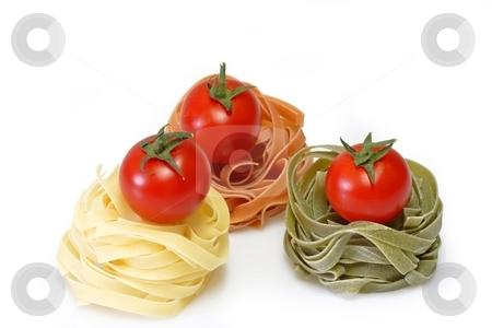 Noodles with Tomato stock photo, Raw pasta on bright background. Shot in Studio. by Birgit Reitz-Hofmann