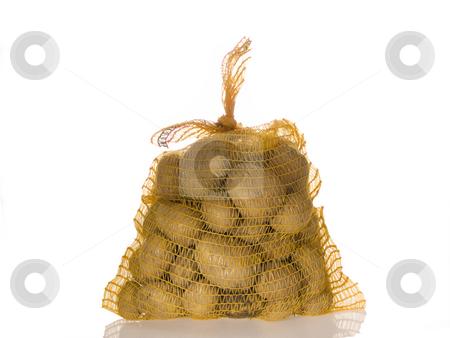 Potato harvesting stock photo, Potaotoes in a sack on bright background by Birgit Reitz-Hofmann