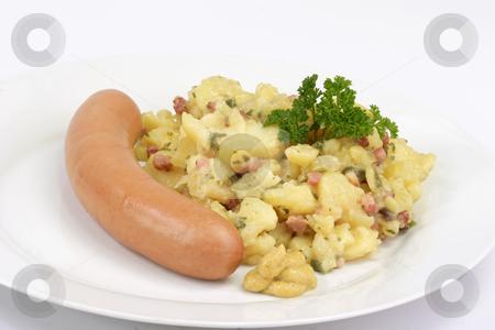 Potato salad stock photo, Crisp cooked sausage with potato salad on bright background by Birgit Reitz-Hofmann